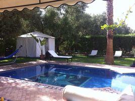 Marrakech Tensift Al Haouz Na Menara Gueliz A saisir une très belle villa à louer meublée de 4 suites avec un beau jardin et une piscine privative situé sur la route de Ouarzazate proche de l'éc 4 卧室 别墅 租